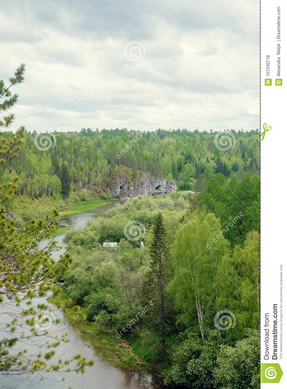 The blue ribbon of the river from the height of the mountains. Wild nature, taiga. Tourism. Far East, Sakhalin Island, Russia.
