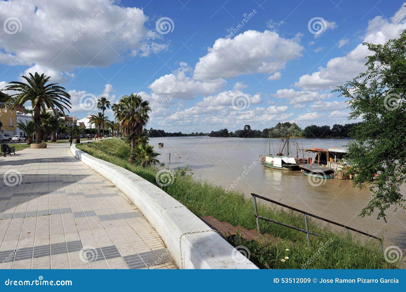 Riverside walk in the river Guadalquivir as it passes through Coria del Rio, Seville province, Andalusia, Spain