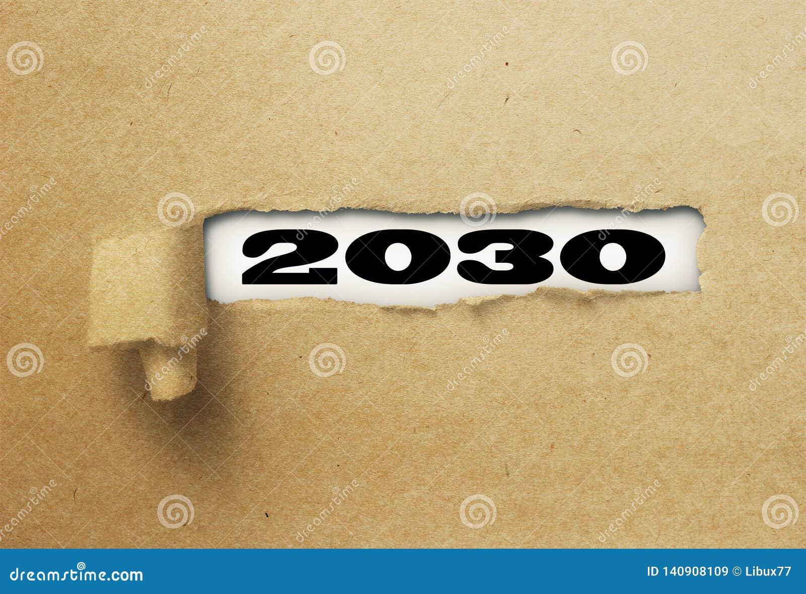 Rivit sönder eller sönderrivet papper som avslöjer det nya året 2030 på vitt