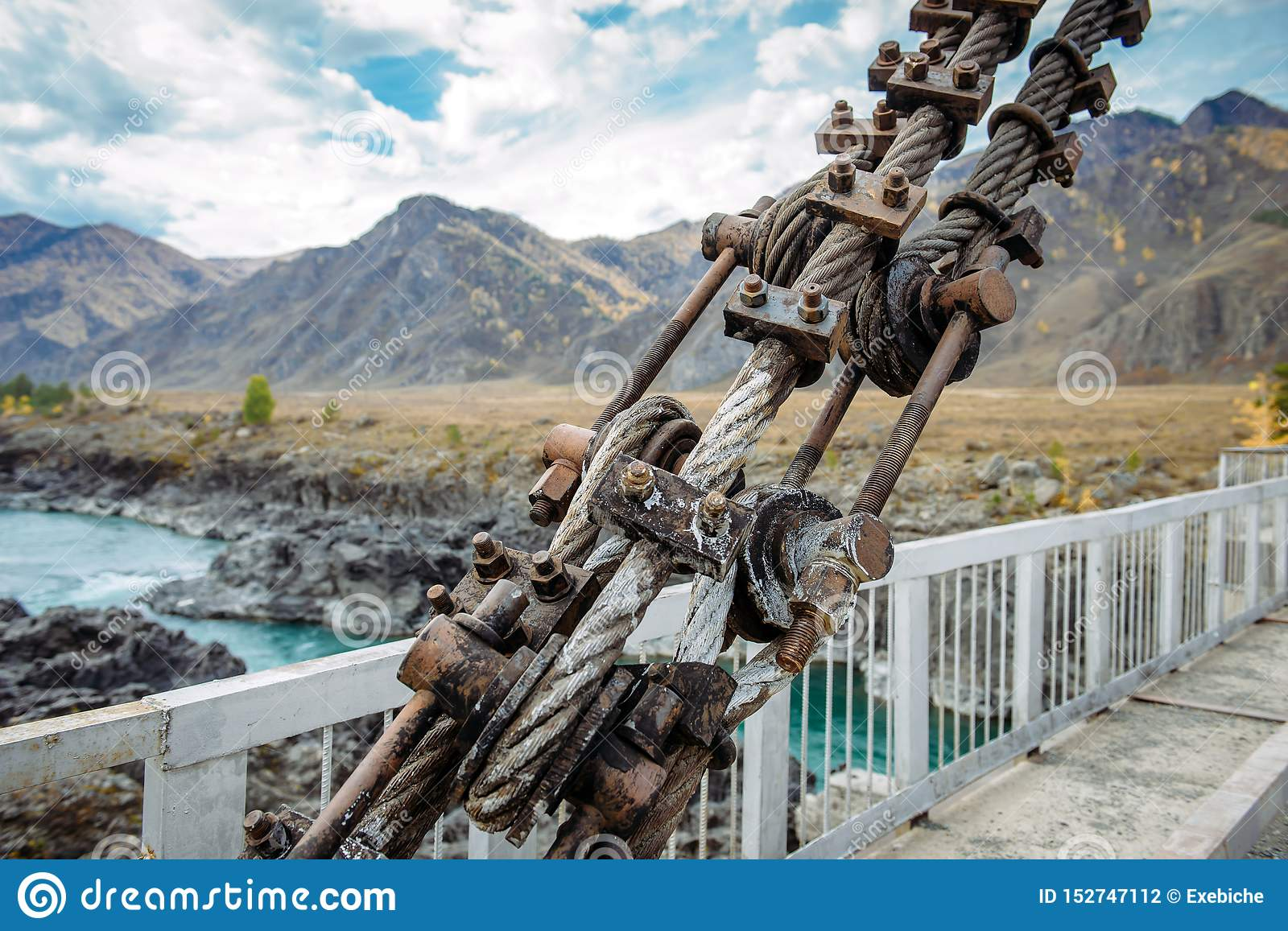 Road bridge over the river in the mountains, metal structure close-up. Location Gorny Altai, Siberia, Russia