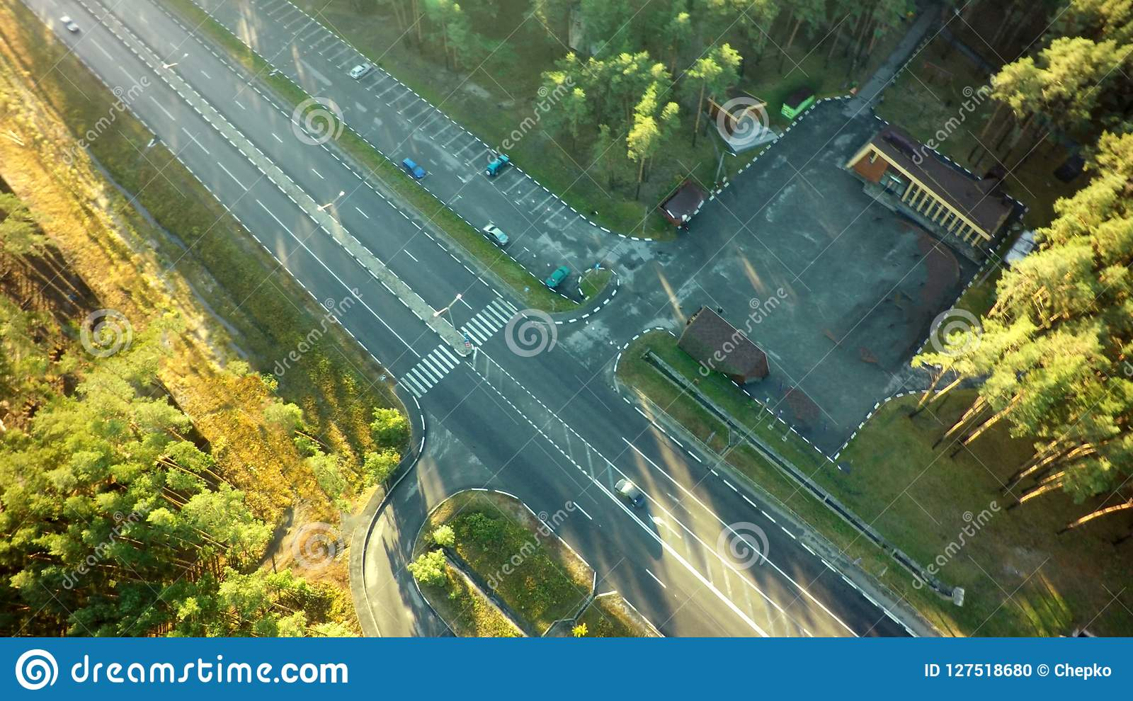 Road for cars aerial view from top around green nature