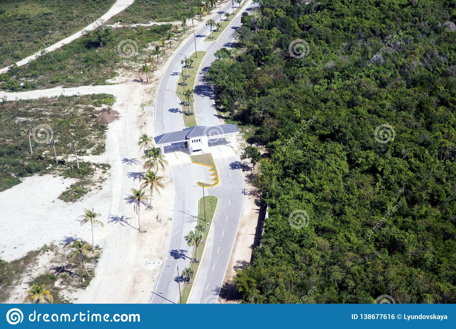 The road, the checkpoint divides the territory of Punta Cana, the Dominican Republic into two parts: a national park and the coast