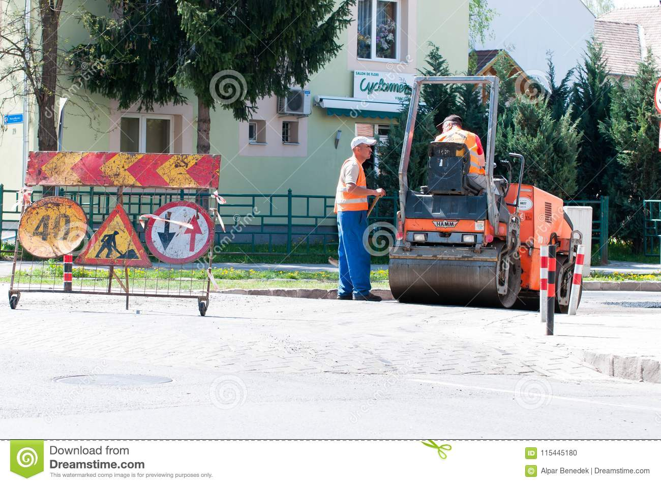Road Construction Workers Repairing The Road Editorial Image