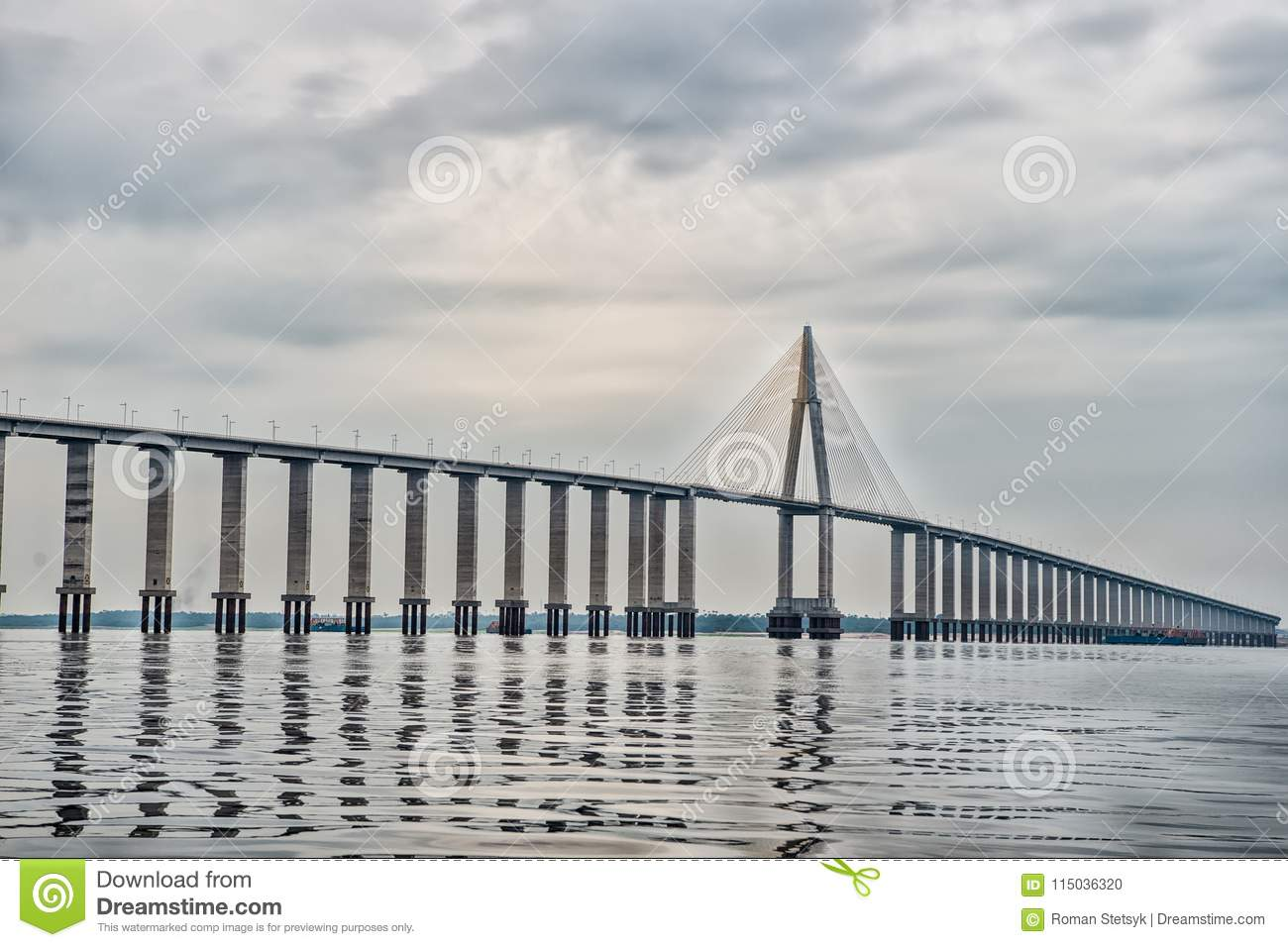 Road passage over water on cloudy sky. Bridge over sea in manaus, brazil. architecture and design concept. Travel destination and