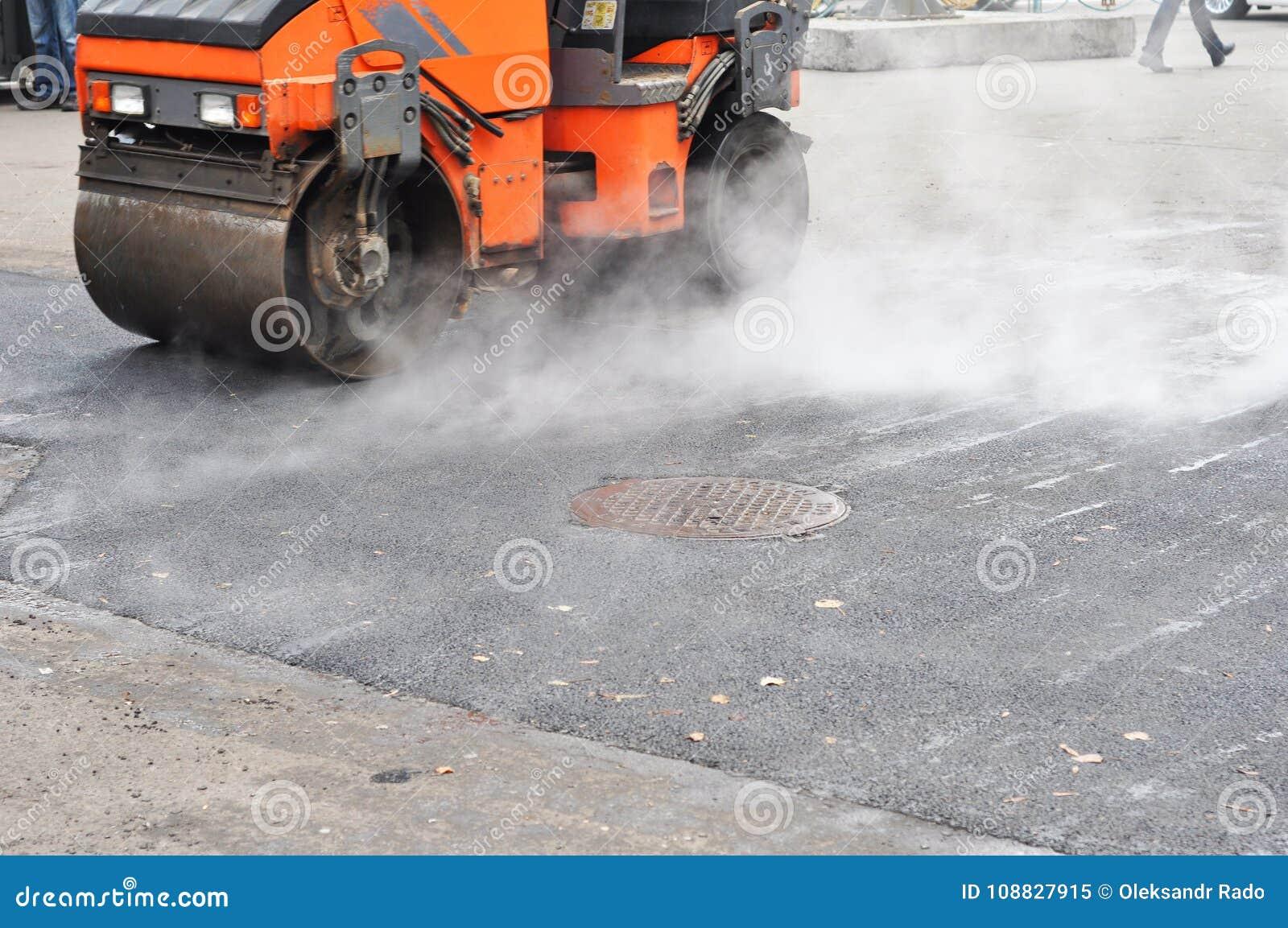 Road repair, compactor lays asphalt. Repair pavement and laying new asphalt