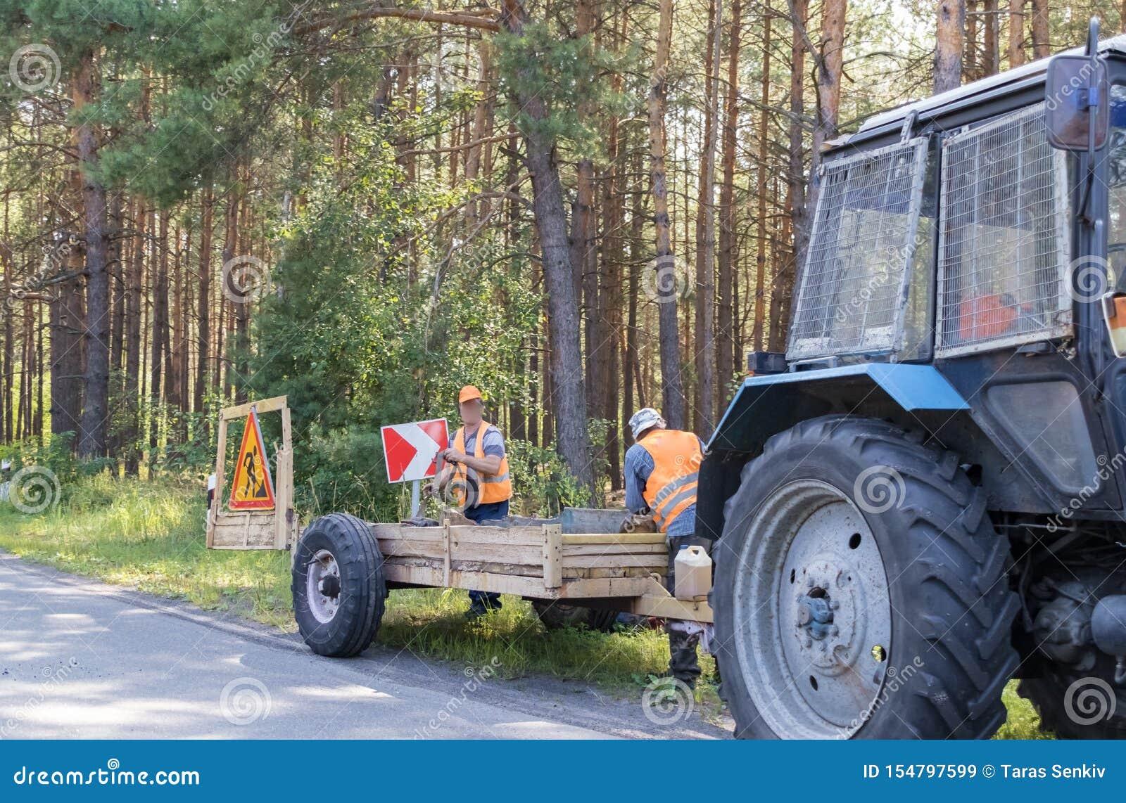 Road repair by a team of professional builders