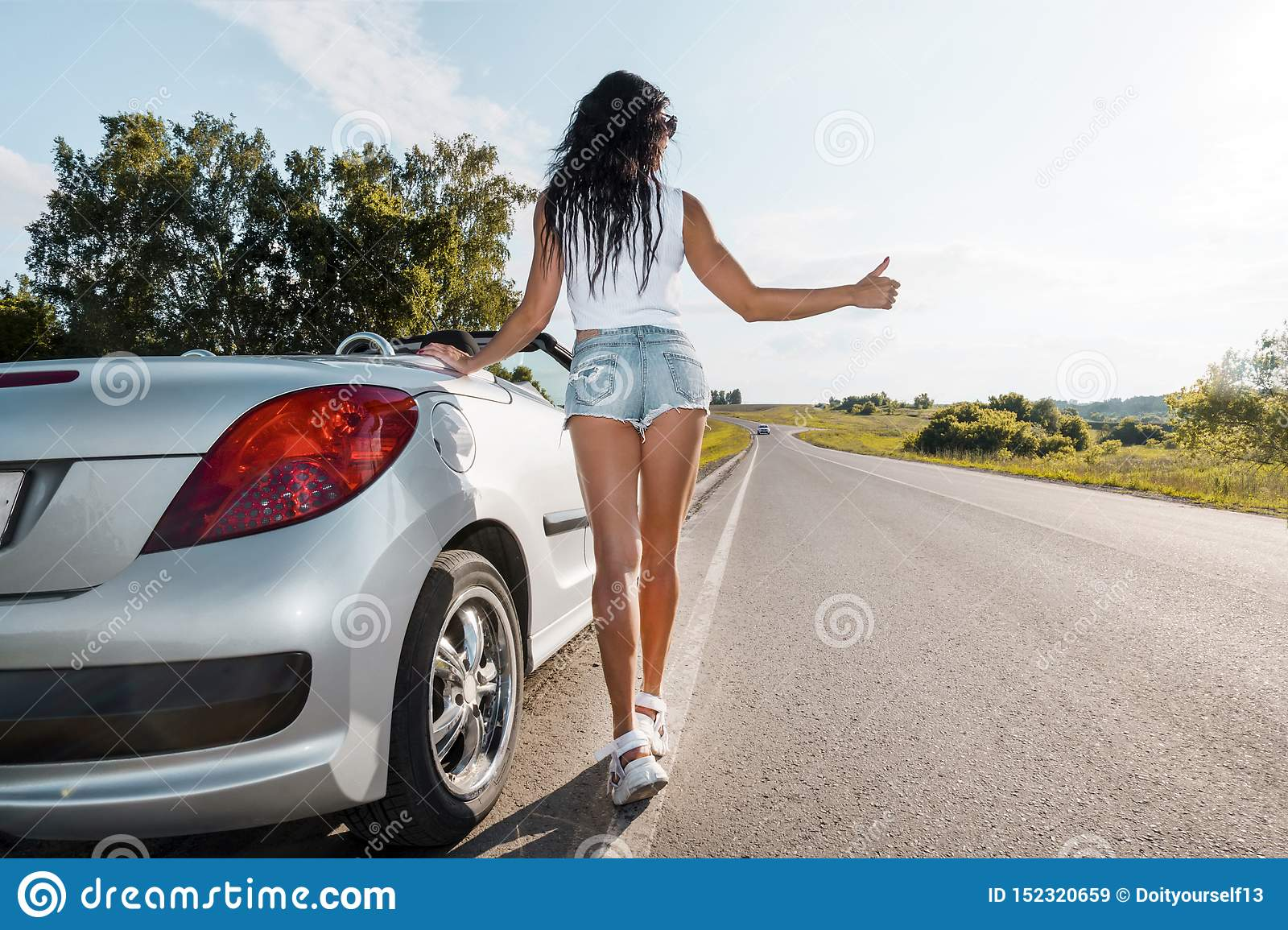 Iowa Gas Prices >> Sexy Woman Hitchhiking Stock Images - Download 19 Royalty Free Photos