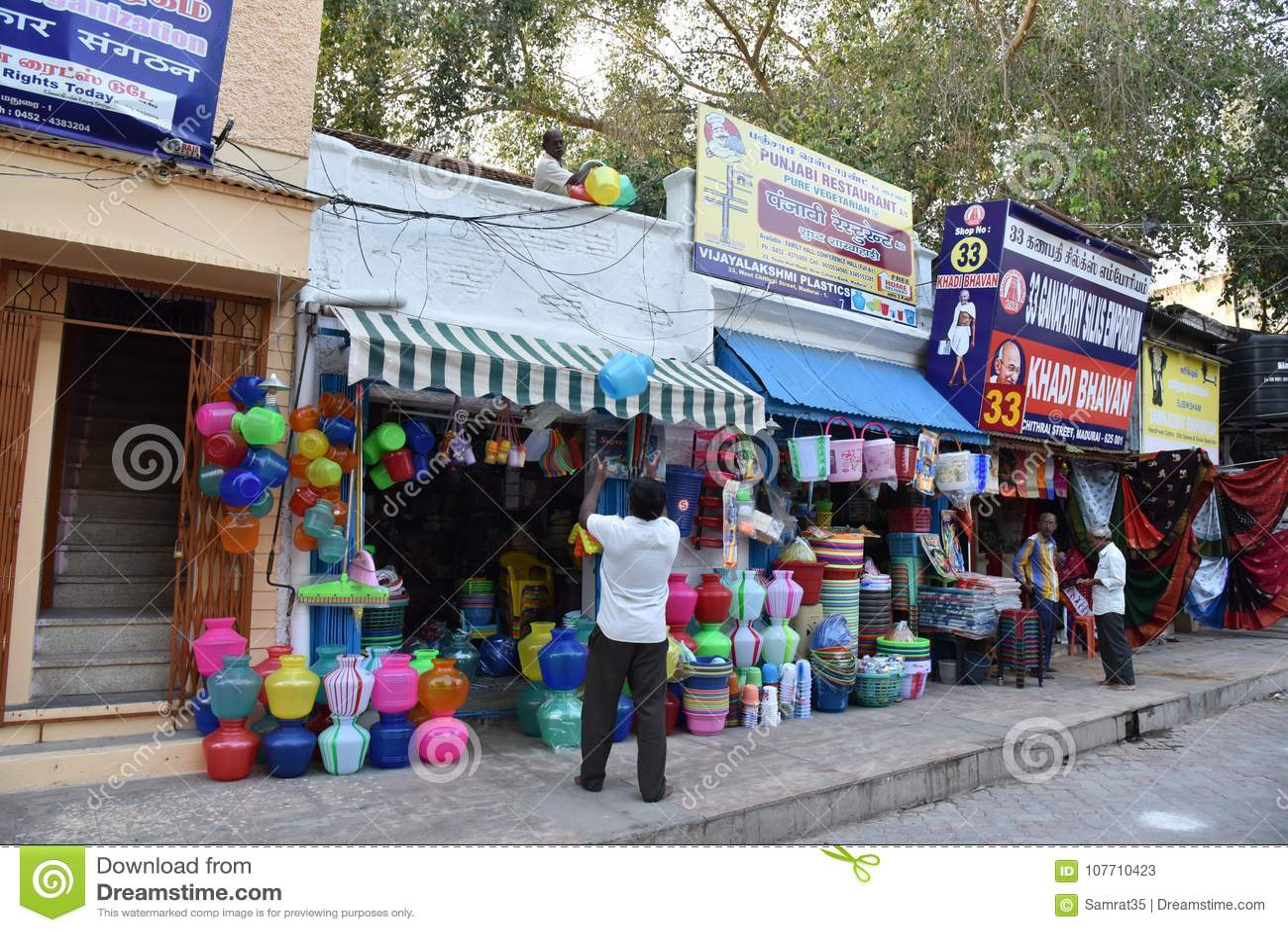 ac18aaed4e5 Meenakshi Sundareswarar Temple or Meenakshi Amman Temple is located in the  holy city of Madurai, Tamil Nadu, India. Road side shop near the temple.