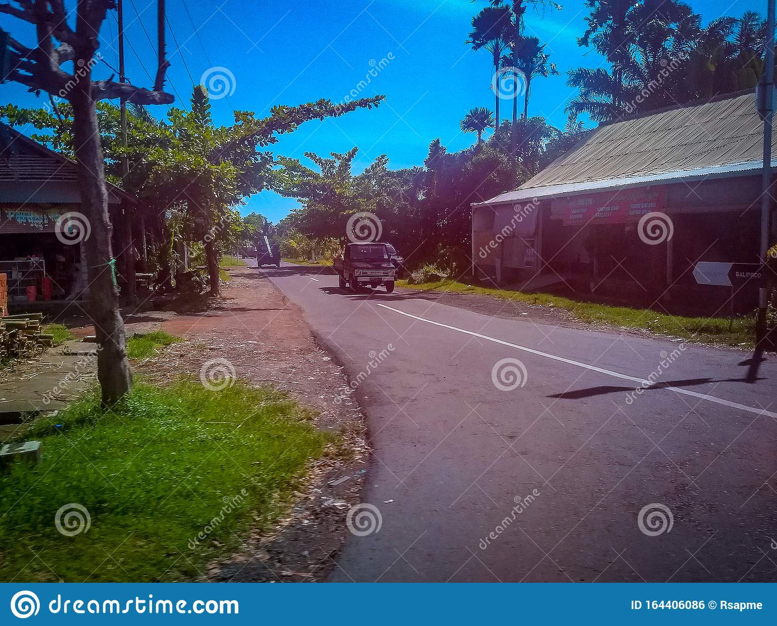 Road Side View In A Village At Bali Indonesia Bali Street View With Light Traffic Editorial Photo Image Of Street View 164406086