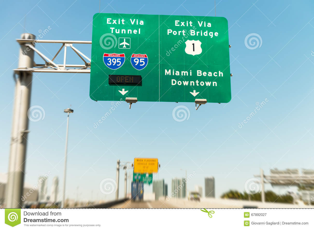 road signs in miami from a moving vehicle stock image - image of