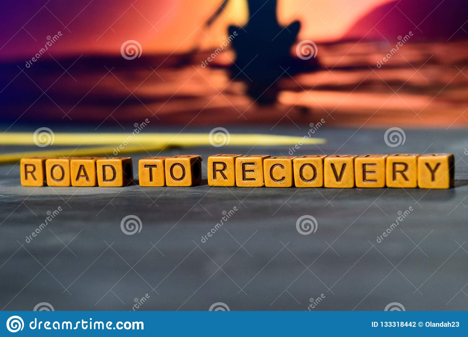 Road to recovery on wooden blocks. Cross processed image with bokeh background