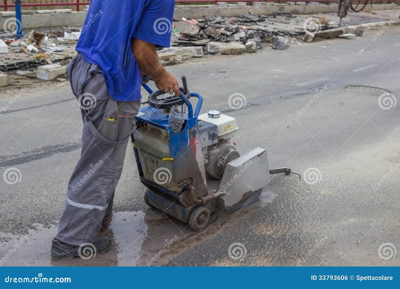 Road Worker Cutting Asphalt Road 3 Royalty Free Stock