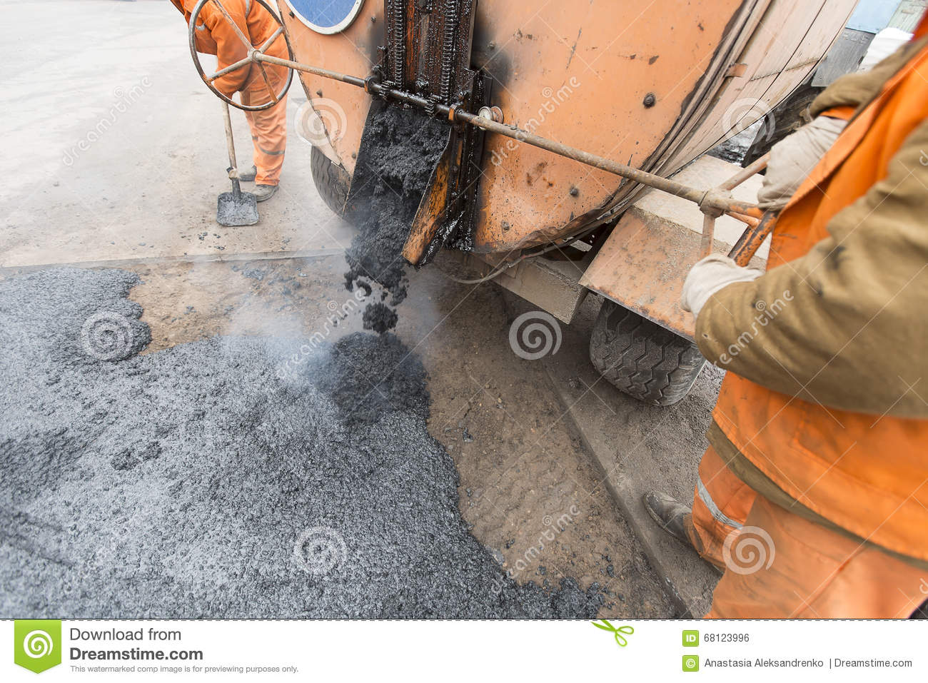 Road Workers Laid Asphalt, Repairing The Road Stock Photo - Image ...
