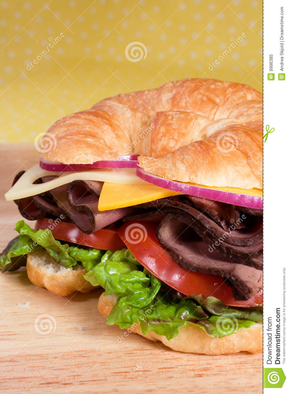 Roast beef sandwich on a croissant with cheddar and swiss cheeses ...