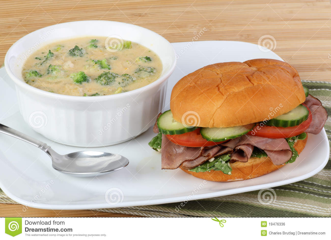 ... sandwich with cucumber, lettuce, tomato and a bowl of broccoli soup