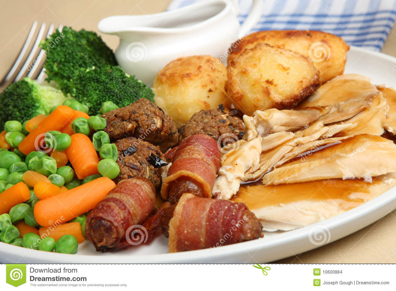 Roast chicken dinner stock photo image of meat sauce for Thanksgiving dinner with all the trimmings