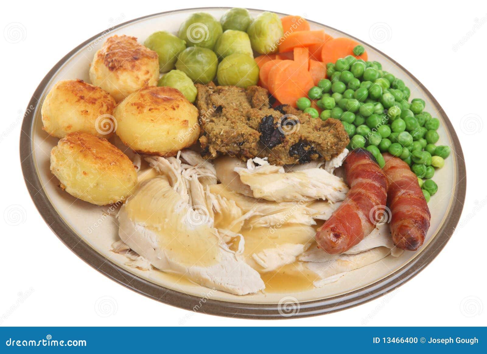 Traditional british roast chicken dinner with gravy