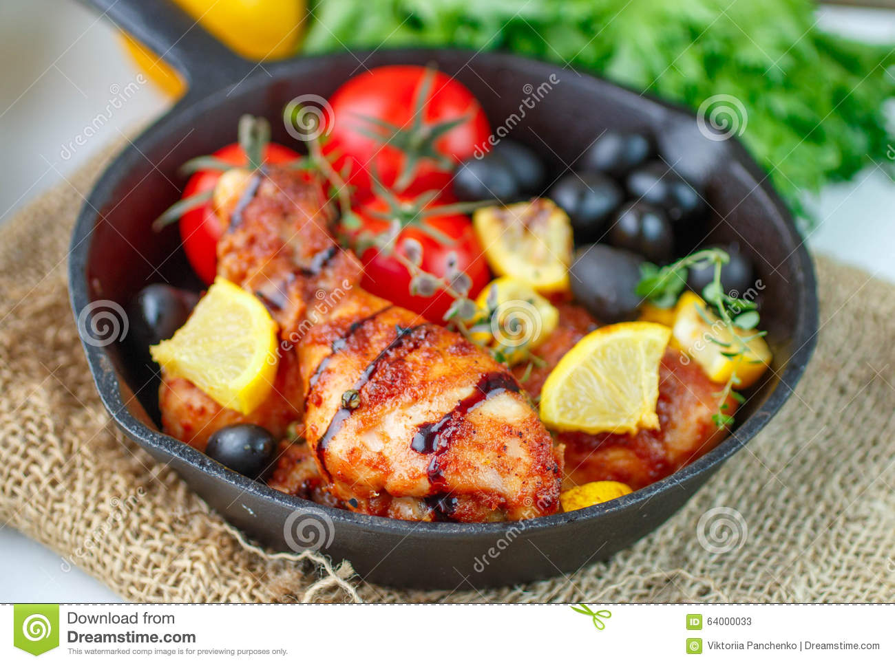 Roast chicken with lemon, olives, tomatoes and thyme. Dinner