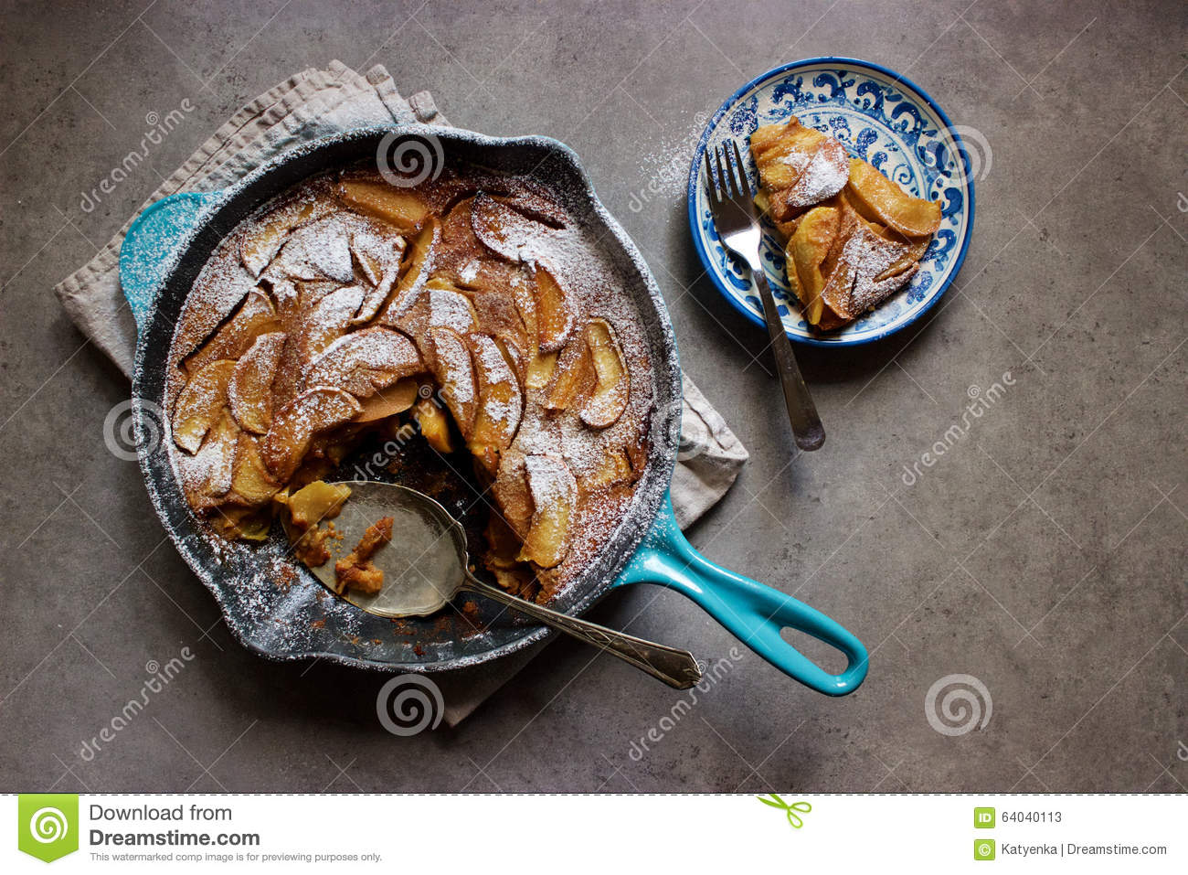 Roasted apple clafoutis (French custard cake) in cast iron pan