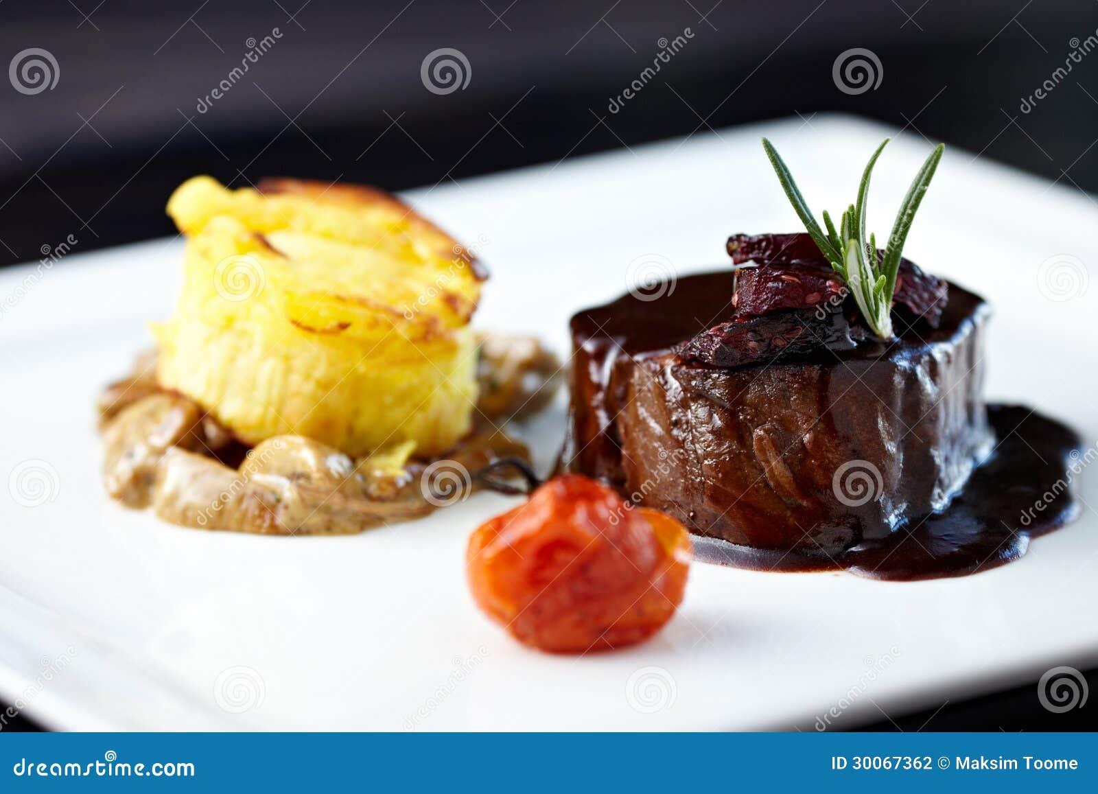 Roasted beef tenderloin with herb-potato muffin, mushroom ragout ...