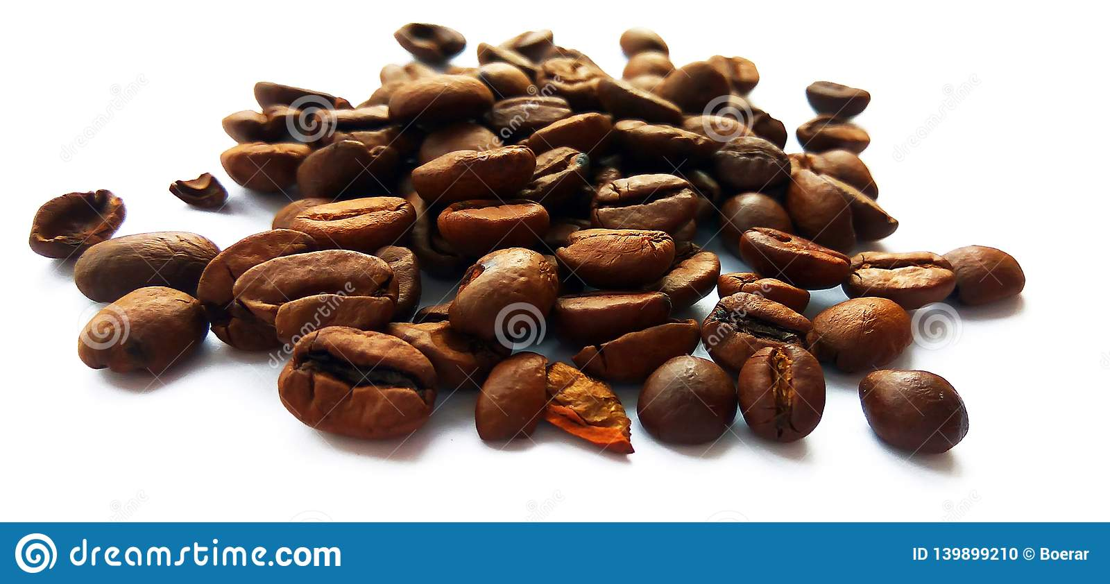 Roasted brown coffee beans and seeds isolated