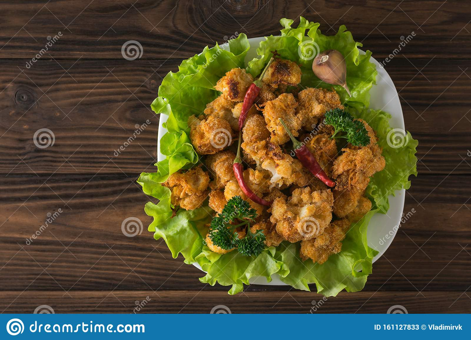 Roasted Cauliflower Inflorescences With Pepper On Lettuce Leaves Flat Lay Stock Image Image Of Background Baked 161127833