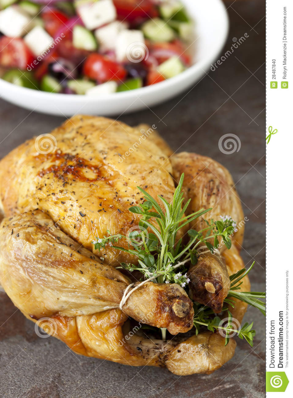 Roasted Chicken With Herbs And Greek Salad Stock Photo - Image ...