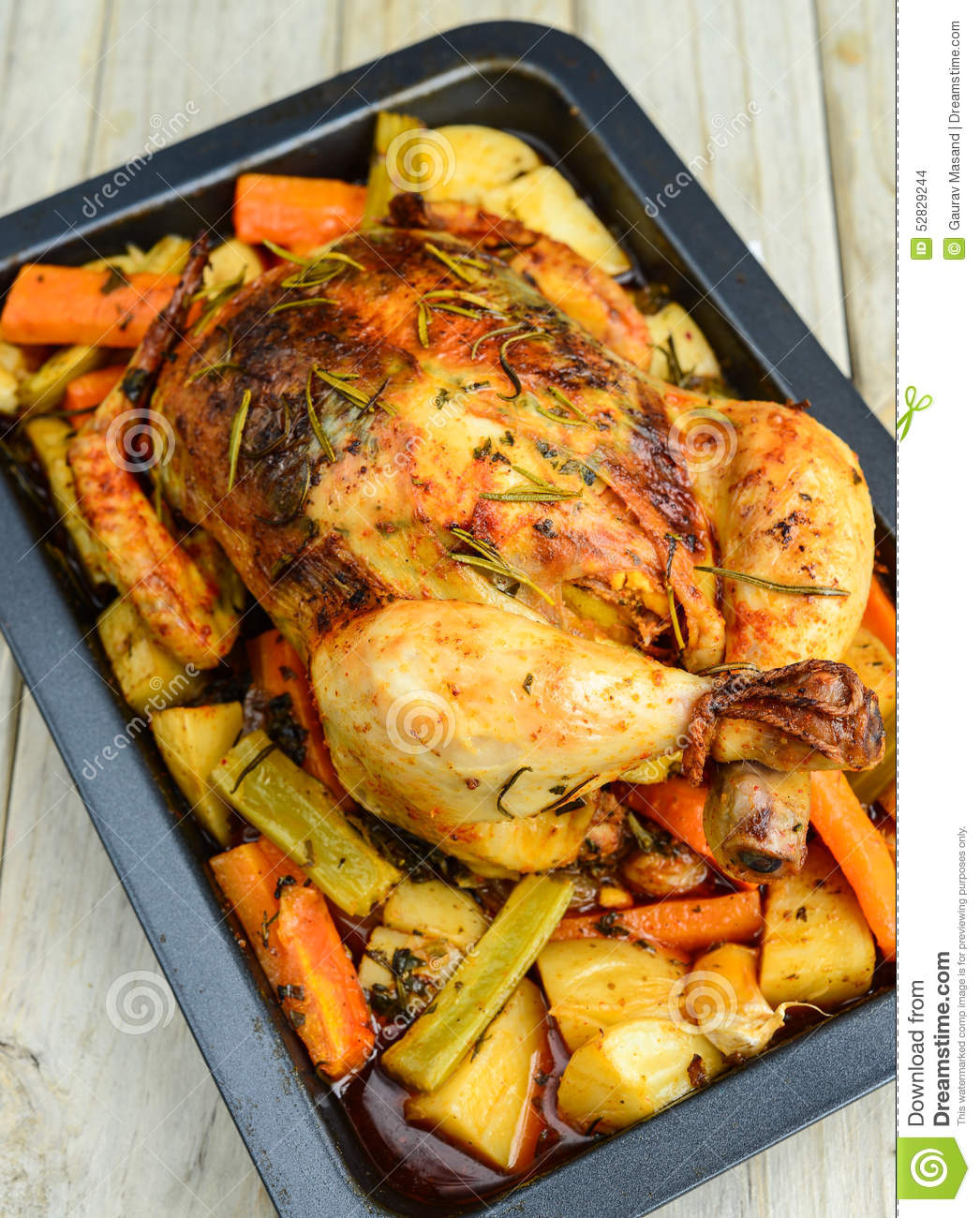 Roasted chicken with herbs and roots vegetables