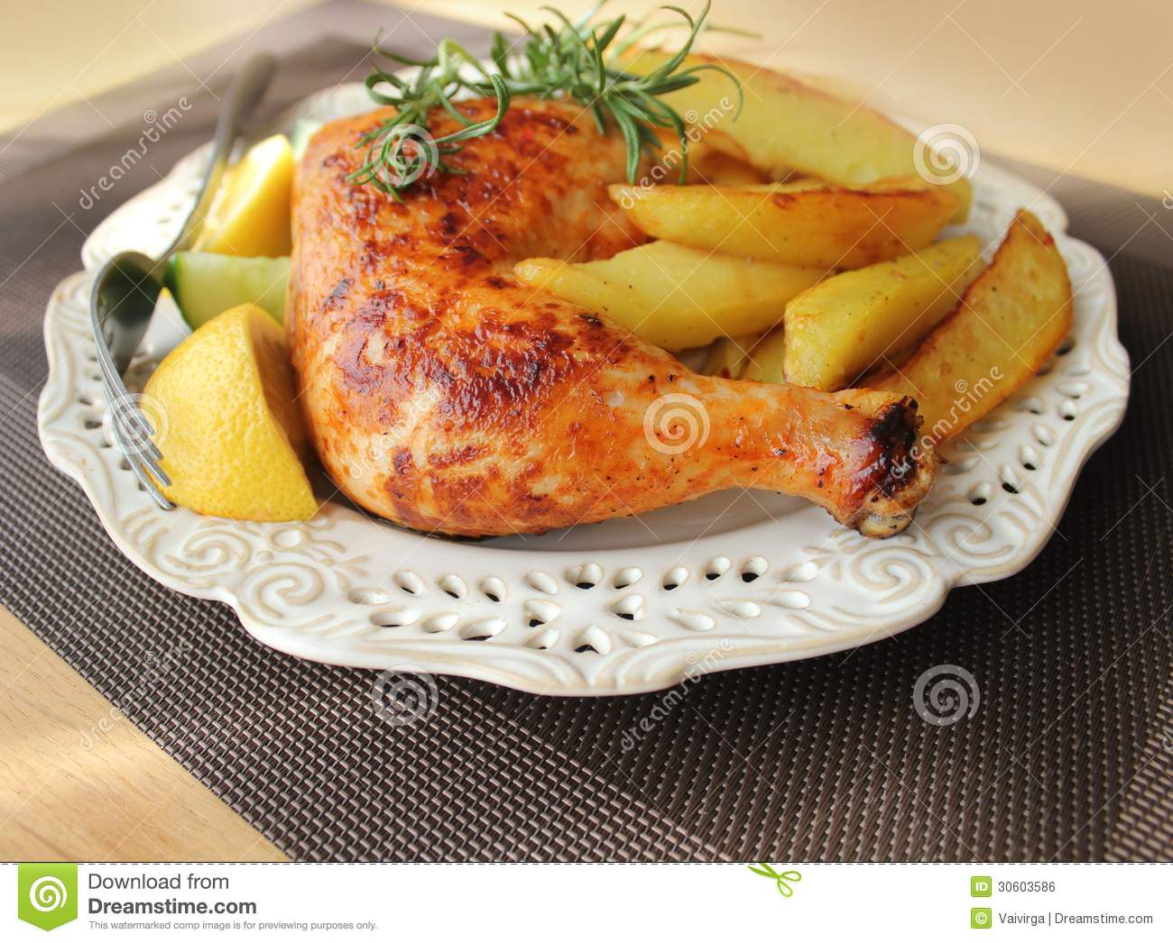 Roasted Chicken Leg With Fries Potato And Lemon Stock Photo Image