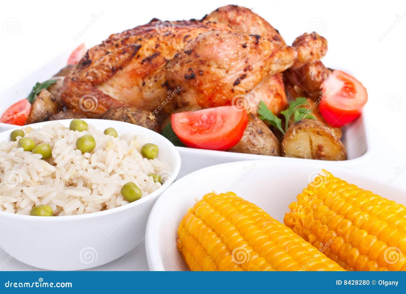 Roasted chicken, potatoes,rice, corn