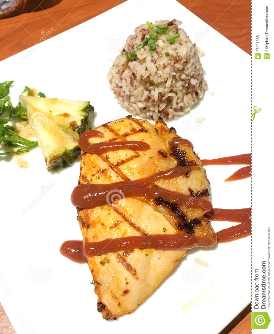 Roasted Chicken With Sauce Served With Brown Rice And Fruit Salad Stock Photo Image Of Fork Foreground 97007388