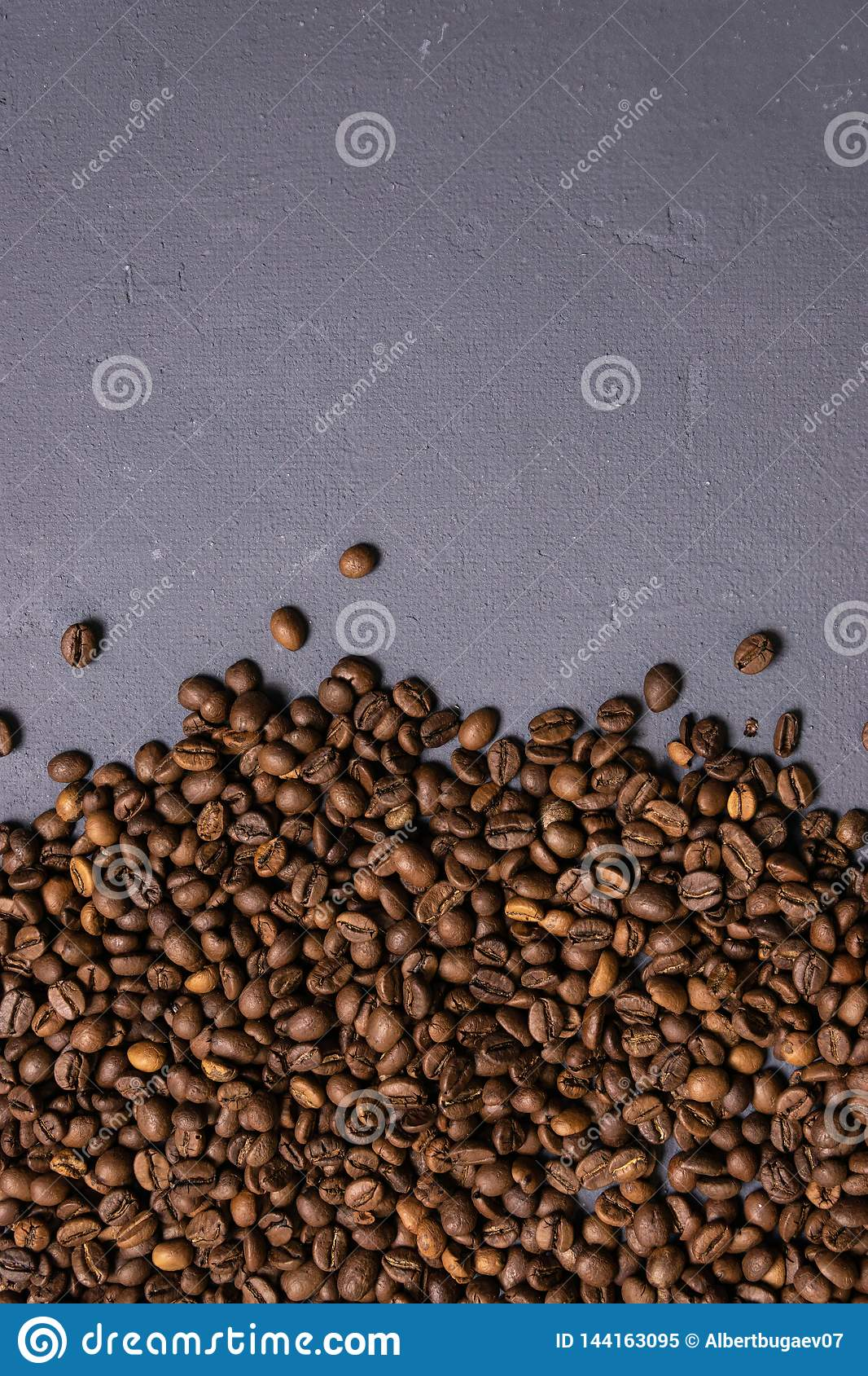 Roasted coffee beans in bulk on a gray concrete background. dark cofee roasted grain flavor aroma cafe, natural coffe shop