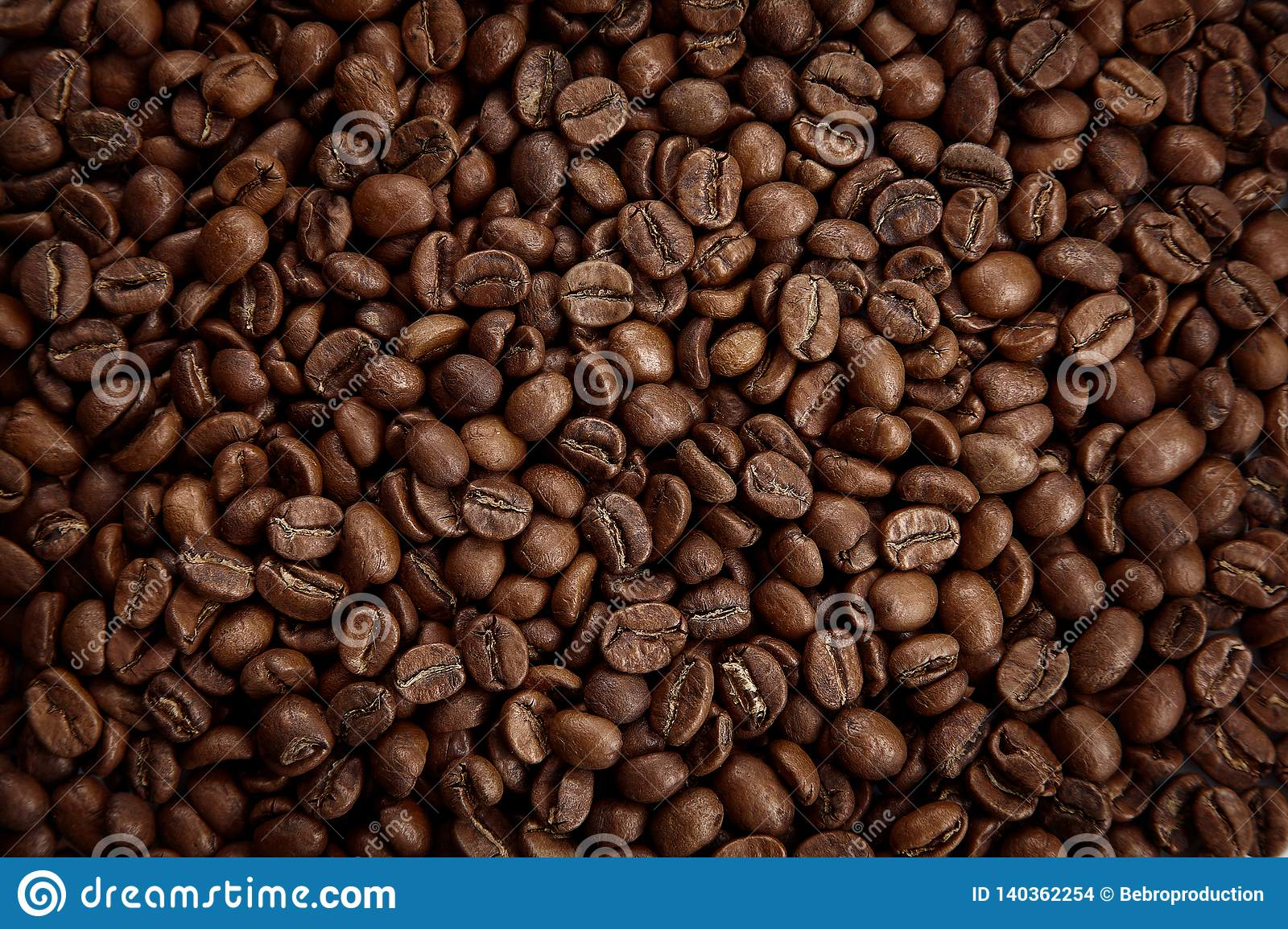 Roasted coffee beans texture. Close up view, top view