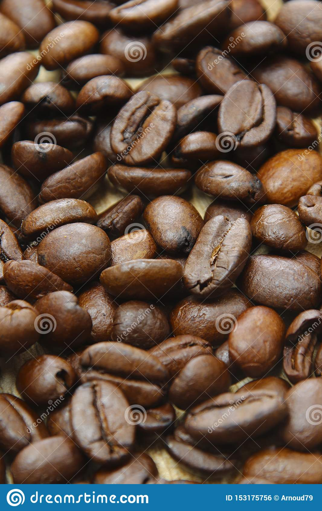 Roasted coffee beans on a wooden background espresso black