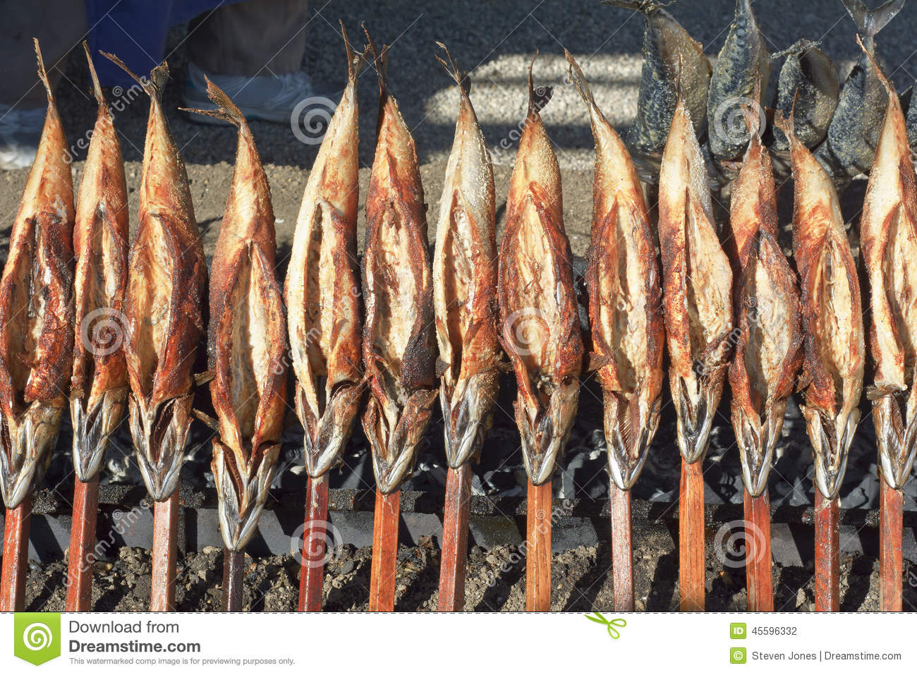 Roasted fish on a stick stock photo image 45596332 for Fish on a stick