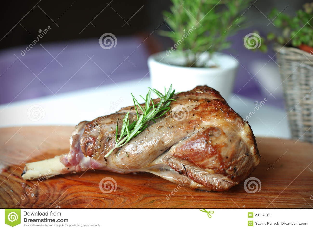 Roasted leg of lamb with rosemary on the cutting b