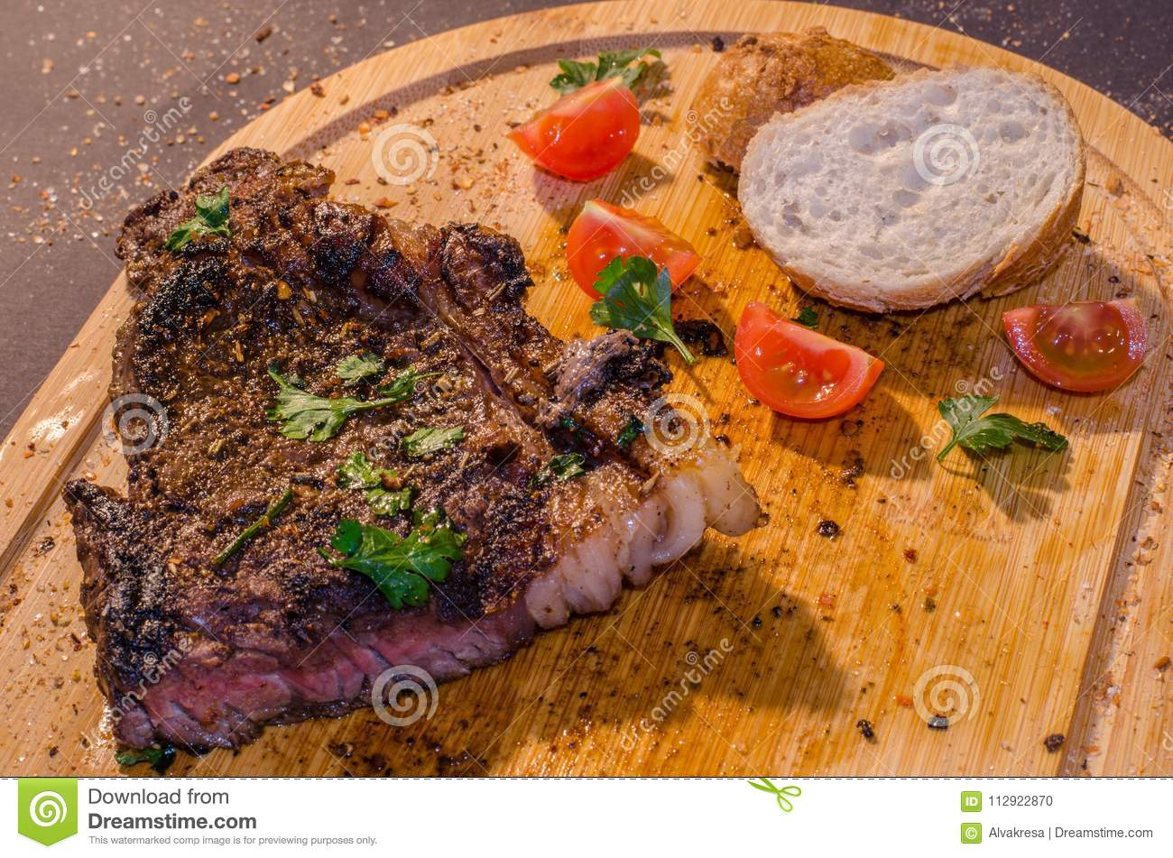 Roasted pork steak with french bread and parsley on top