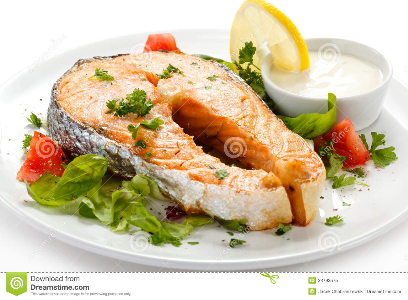 Roasted salmon and vegetables royalty free stock photo for What vegetables go with fish
