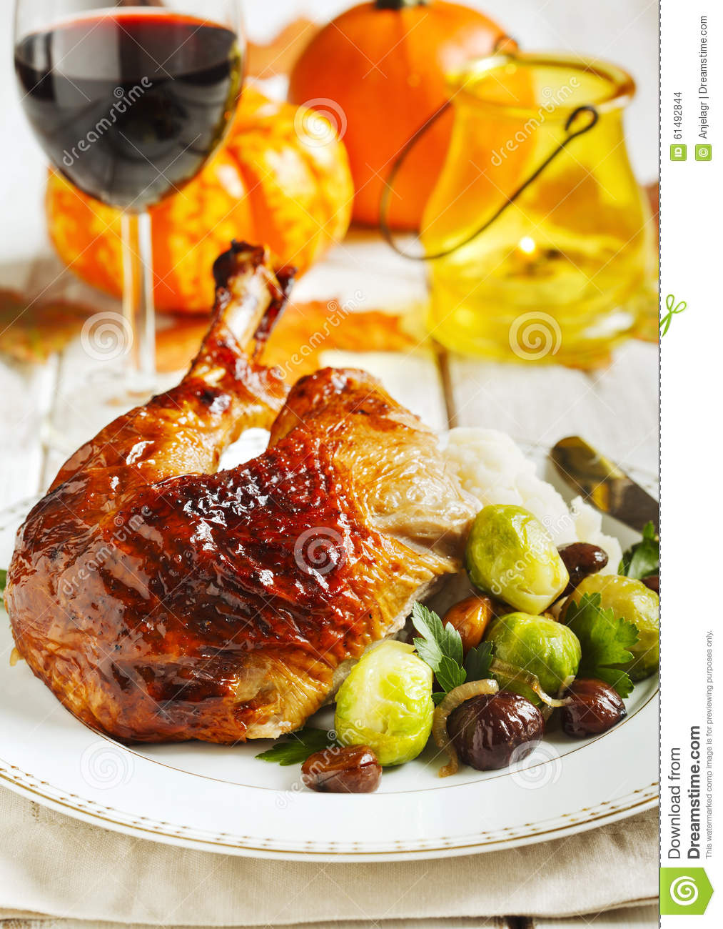 Roasted turkey leg garnished with mash potato, chestnuts and brussels ...
