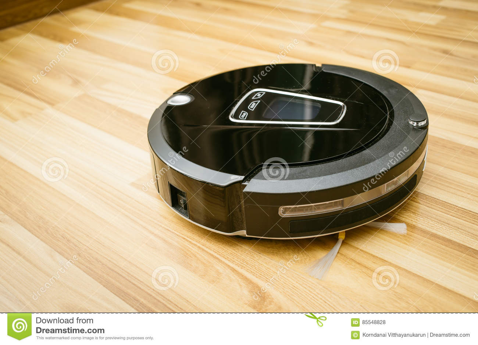 Robot Vacuum Cleaner On Laminate Wood Floor Stock Photo