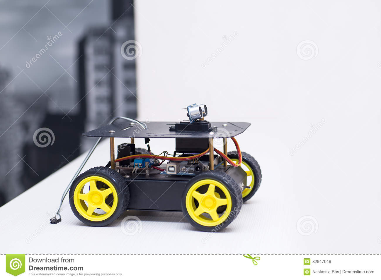 Fine Robot With Yellow Wheels At Home Stock Photo Image Of Obot Interior Design Ideas Tzicisoteloinfo