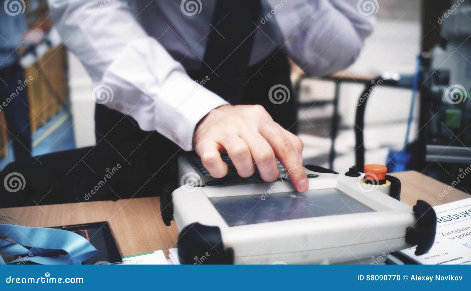 Robotics Engineer Uses Industrial Touchscreen Computer Stock Photo