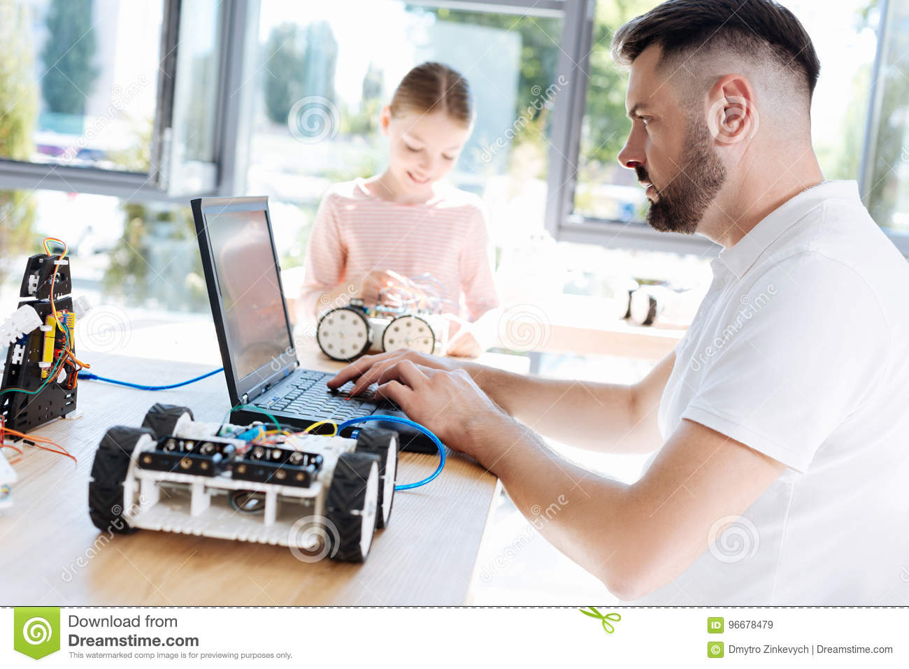 Robotics Teacher Researching For New Project Ideas Stock Image
