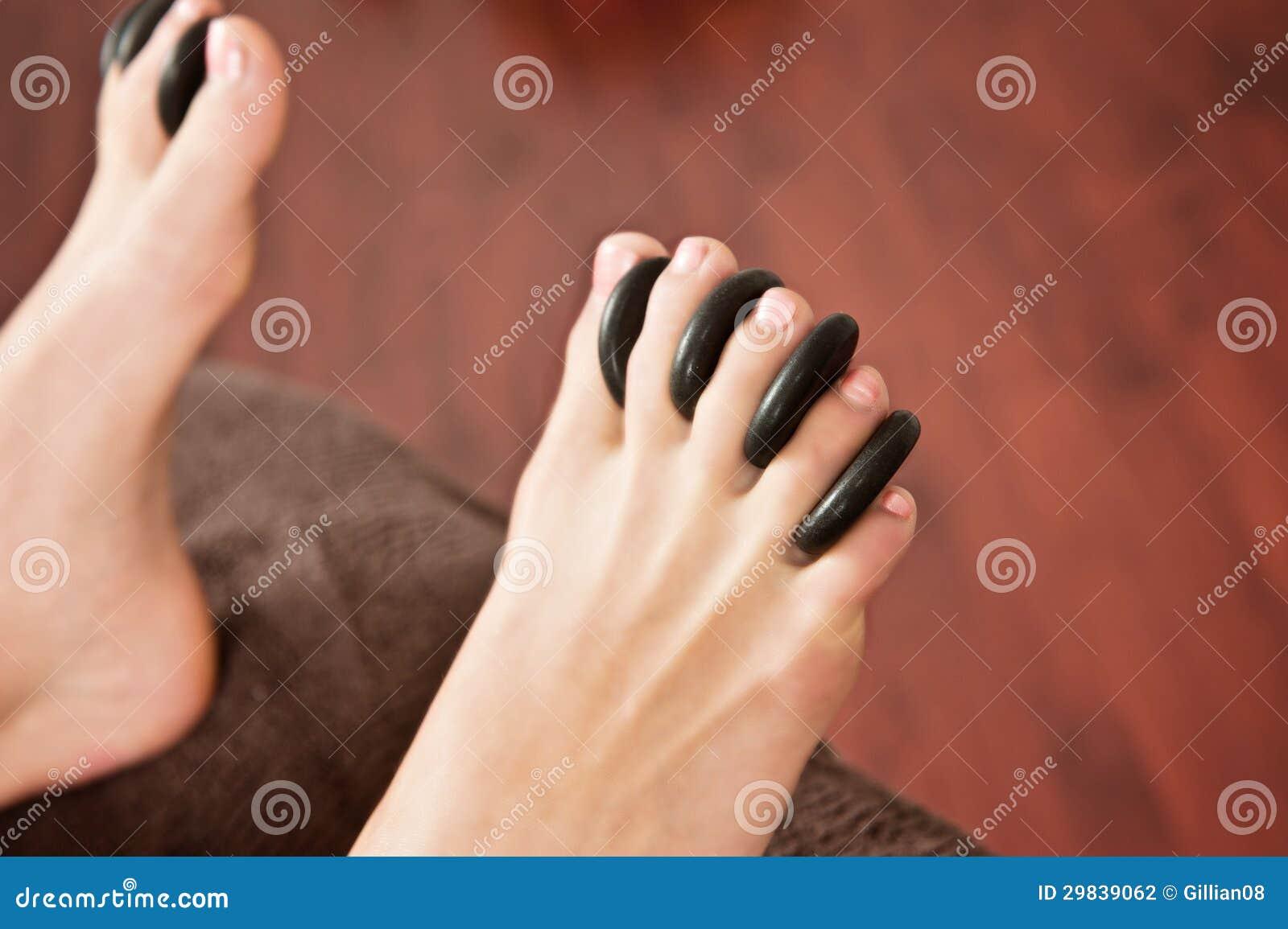 Rochas quentes massagem, pés