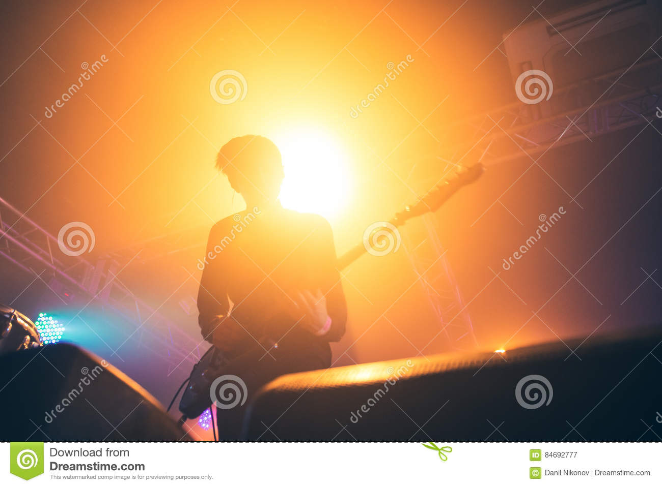 Download Rock Band Performs On Stage. Guitarist Plays Solo. Silhouette Of Guitar Player In Action On Stage In Front Of Concert Crowd. Stock Image - Image of back, closeup: 84692777
