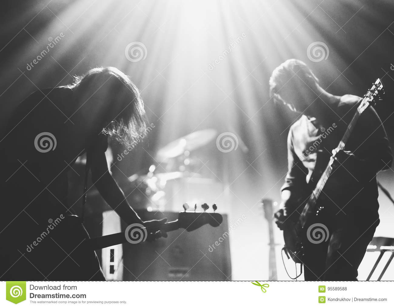 Rock band on a stage in a backlights