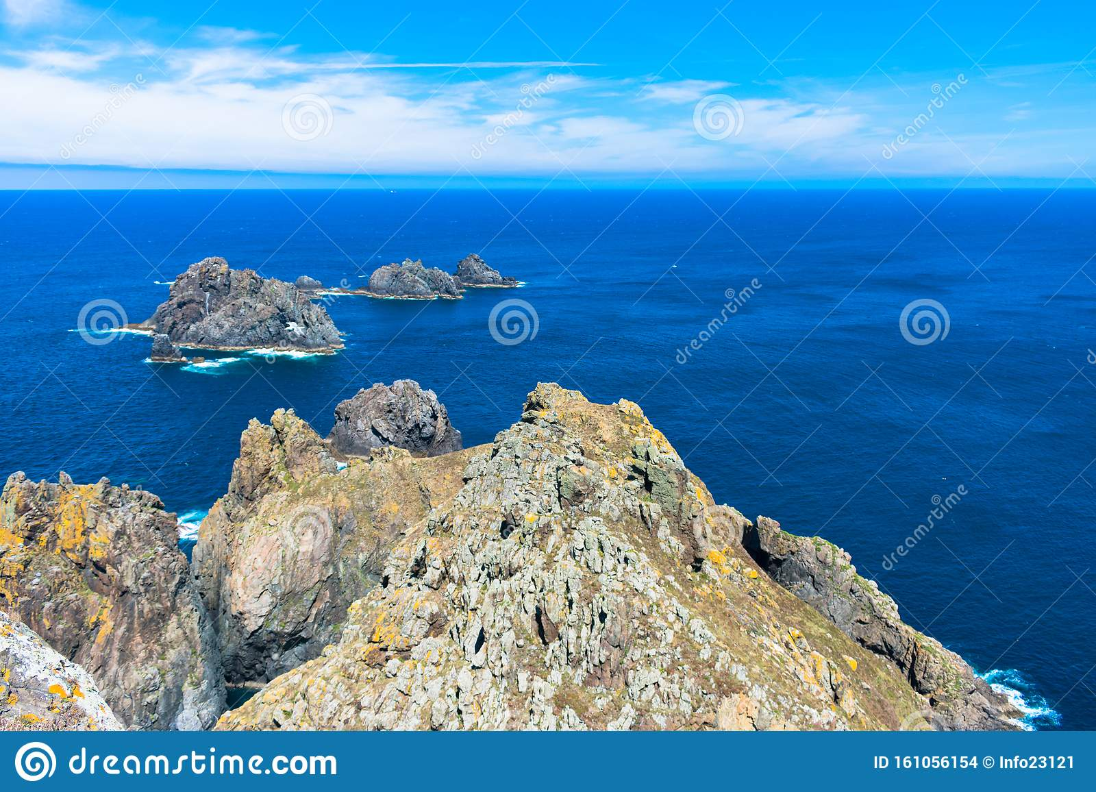 Rock Cliff In The Ocean With Blue Water And Sunny Sky Stock Photo Image Of Dream Relax 161056154