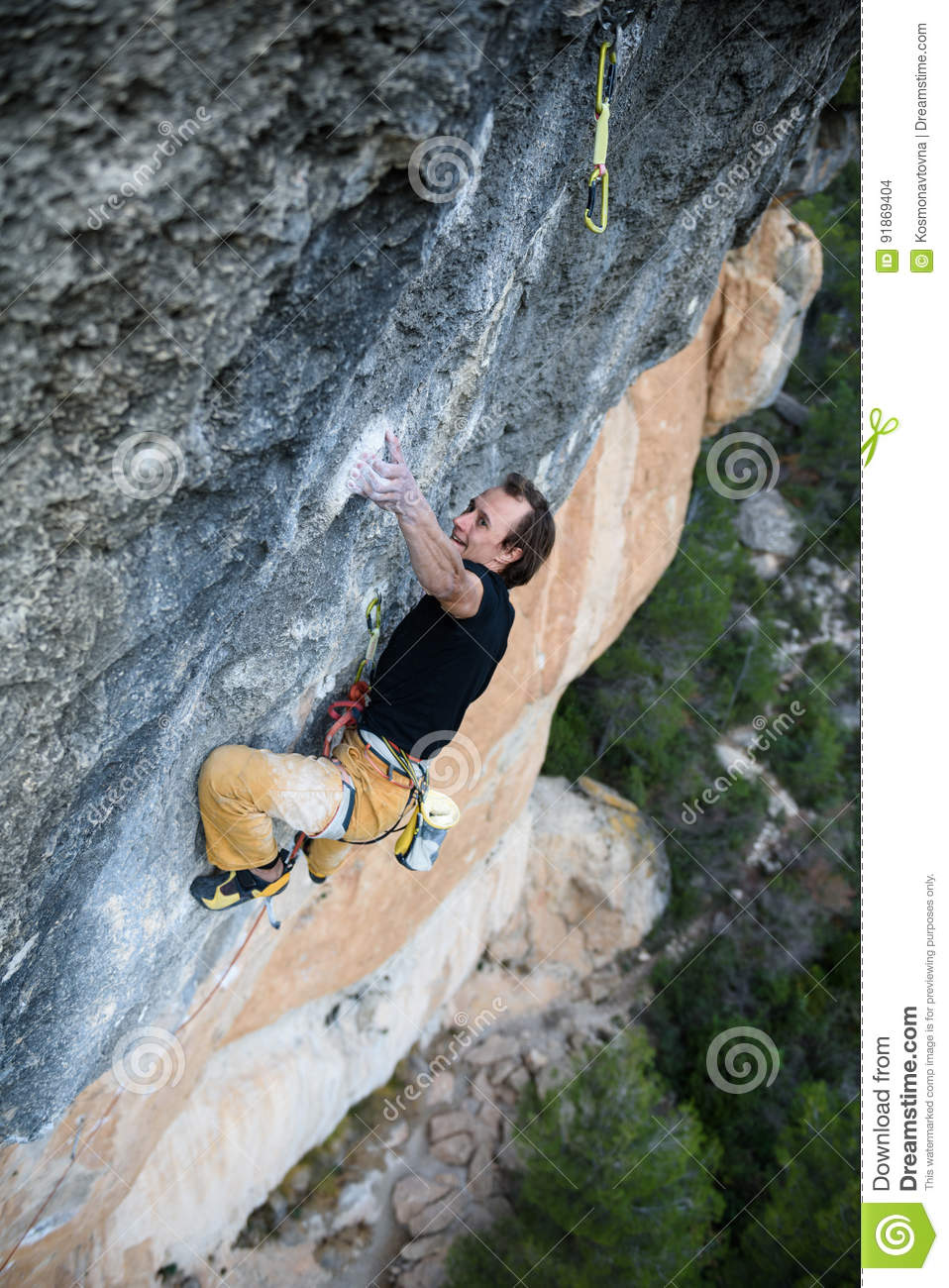 Rock climber ascending a challenging cliff. Extreme sport climbing. Freedom, risk, challenge, success. Sport and active life
