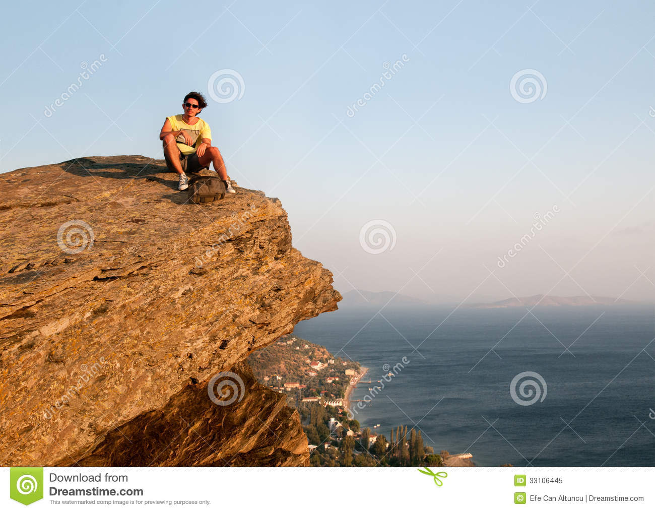 Displaying 19> Images For - Man Sitting On Top Of Mountain...