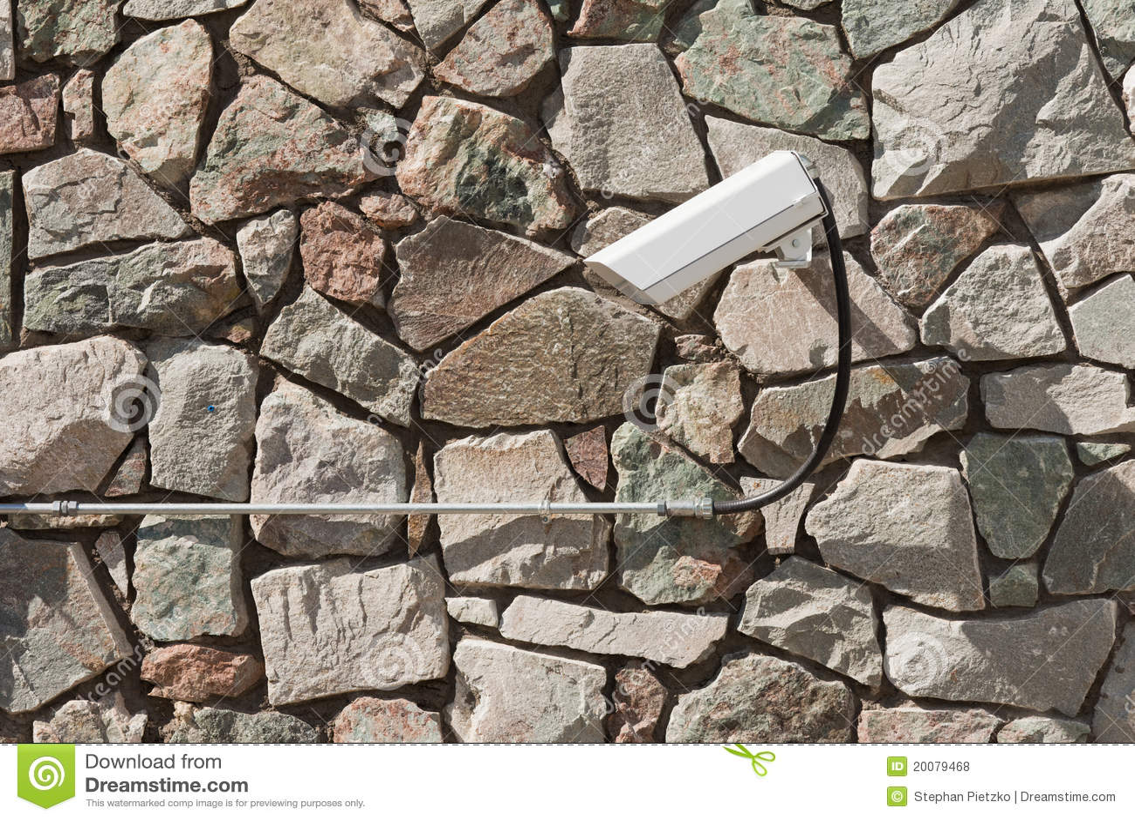 Rock Camera Surveillance : Rock facade with security surveillance camera stock photo image of